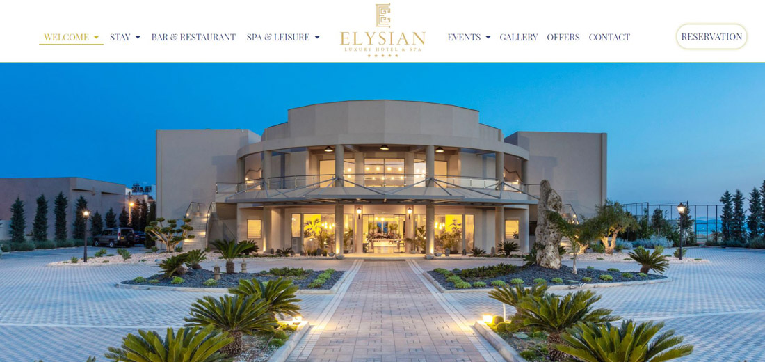 Portfolio image of a website page, created for a client's hotel. Image of the hotel building with lights on at the evening, as well as a website's menu and logo.
