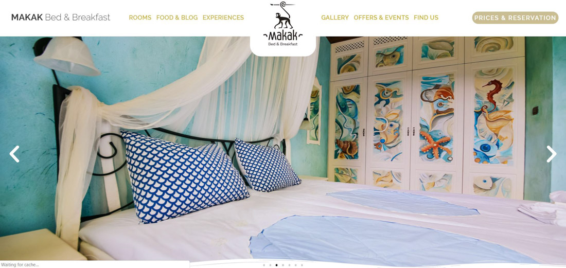 Portfolio image of a website page created for a client's hotel. Beautiful room with a bed and a hand painted wardrobe, together with a website's menu and logo.