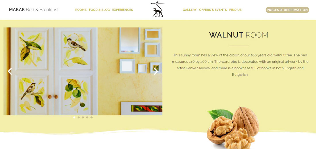 Portfolio image of a website page created for a client's hotel. Presentation of a walnut colour bedroom and a decorative walnut nut, together with a website's menu and logo.