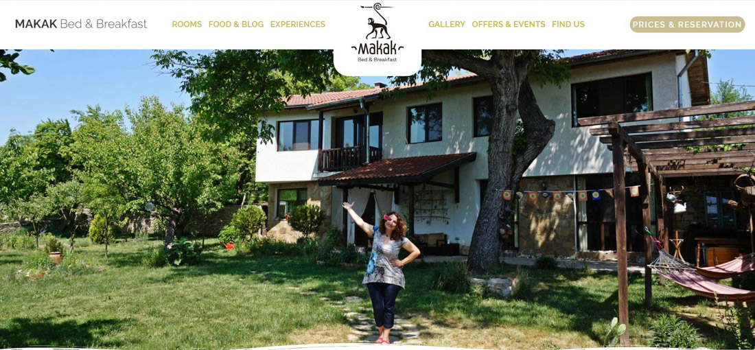 Portfolio image of a website page created for a client's hotel. Beautiful green yard with a house and a woman, welcoming guests, together with a website's menu and logo.